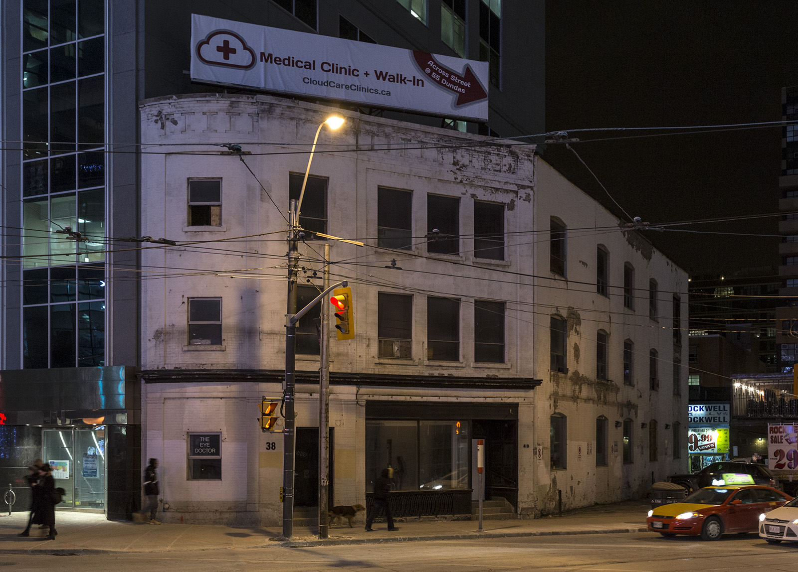 20140130. Expropriated. Gutted. But no development application. 38-40 Dundas St E, Toronto, once an Hakim Optical.