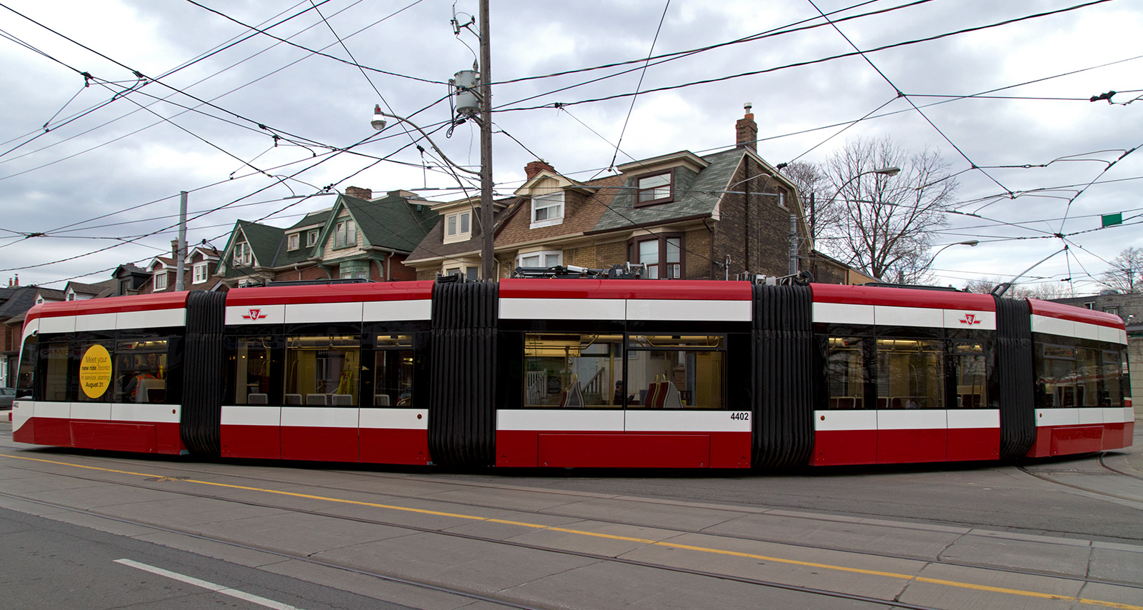 20140506. My first on-street view of the TTC's new Toronto Flexity Outlook streetcar (exiting Bathurst Stn).