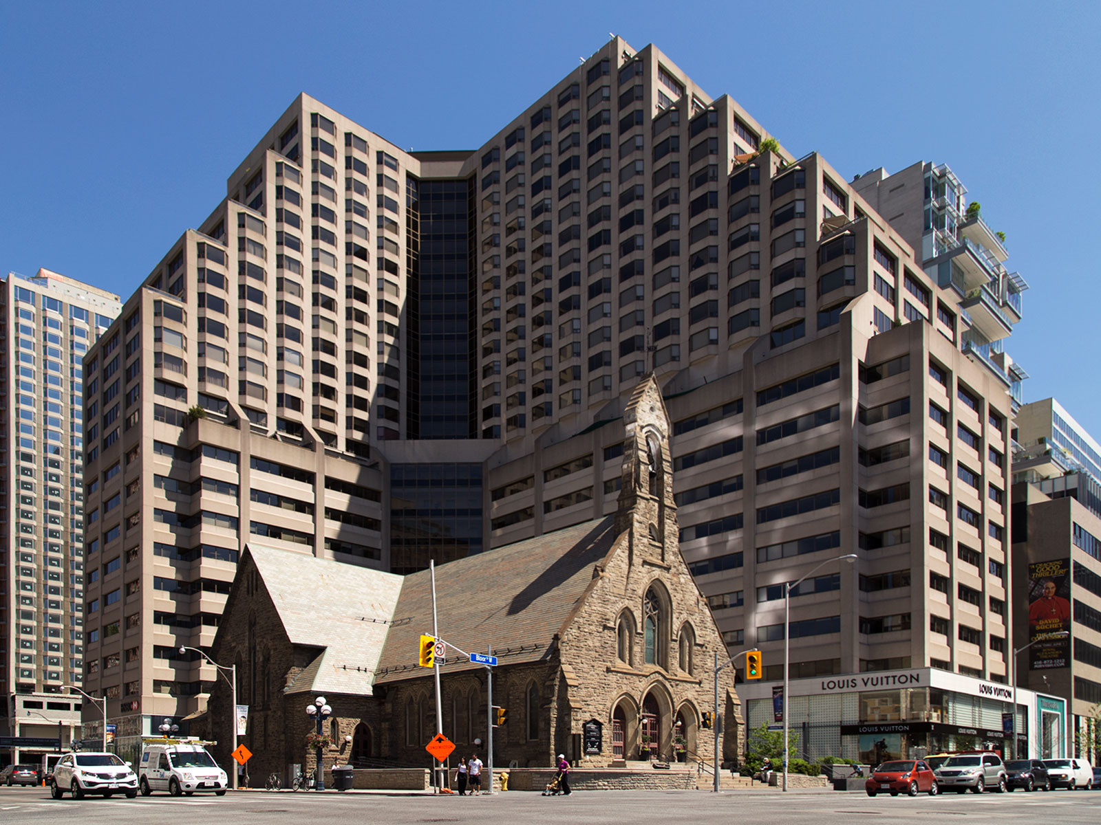 20140608. The Renaissance Plaza towers over the Church of the Redeemer (Avenue Rd and Bloor St, Toronto).