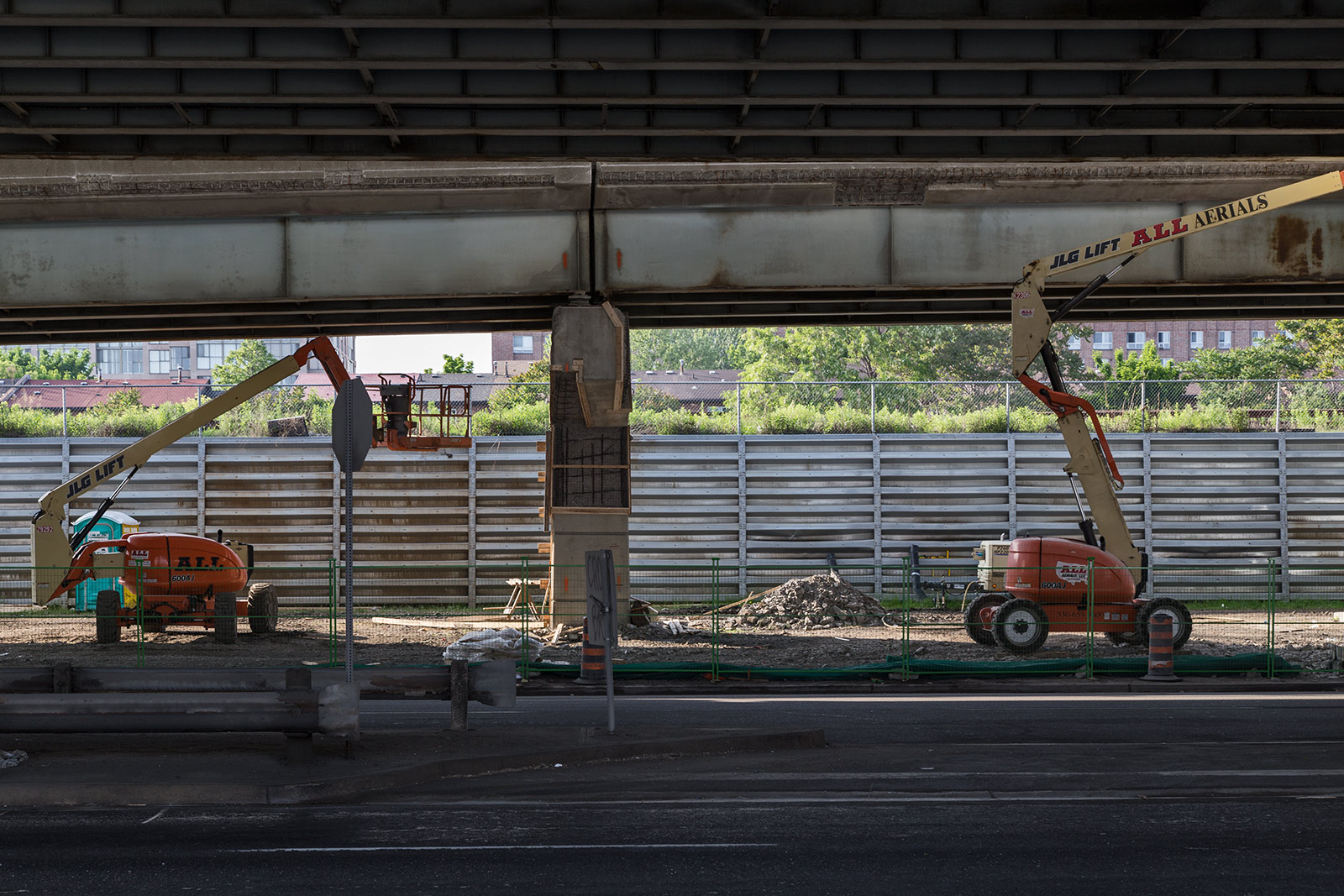 20140617. Aerial lifts await a new day of work on the east Gardiner Expressway in Toronto.