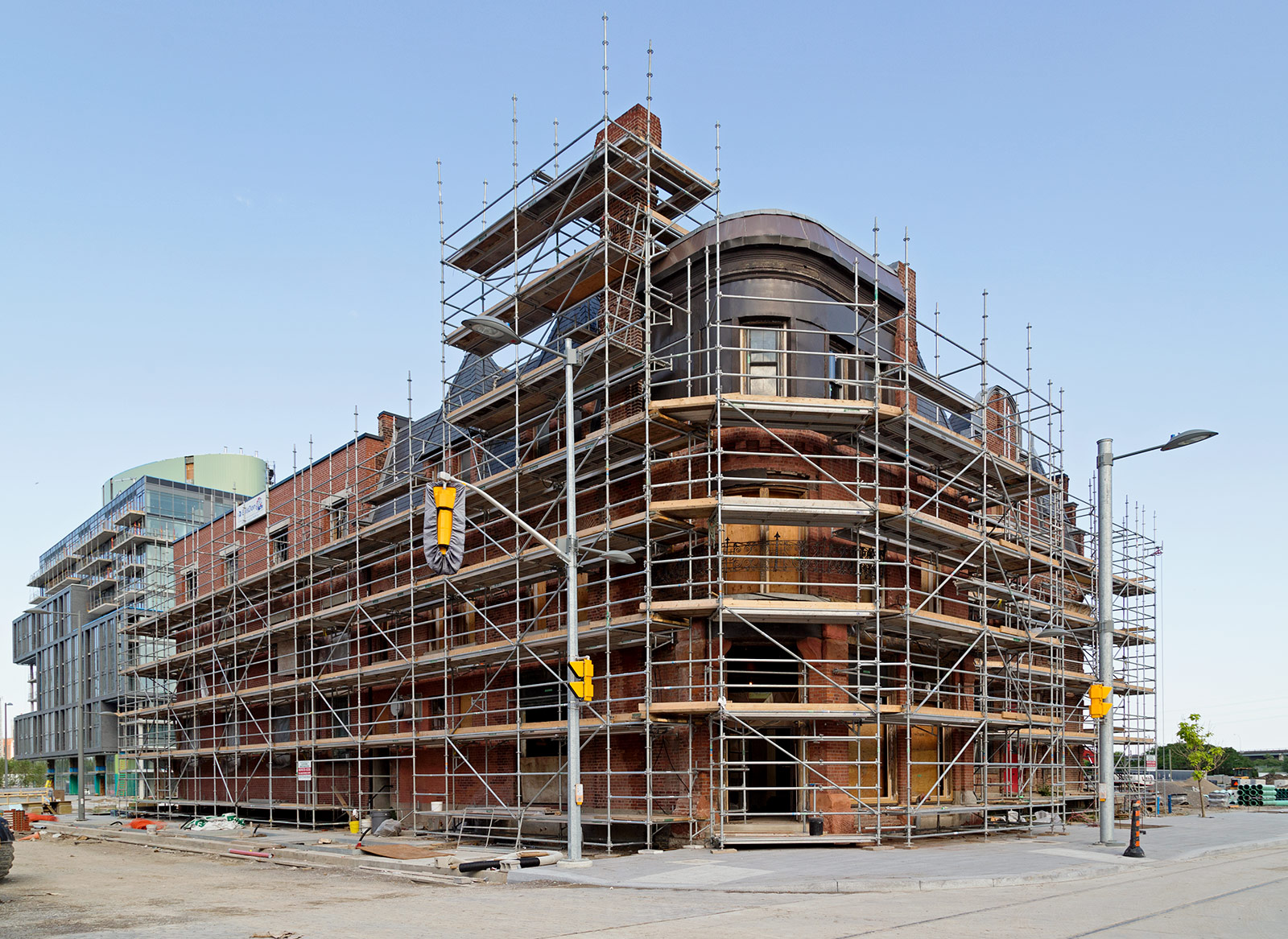 20140626. The old Canary Restaurant (c.1859), covered in platform rigging, is getting a facelift (PanAM Athlete's Village or Canary District, Toronto).