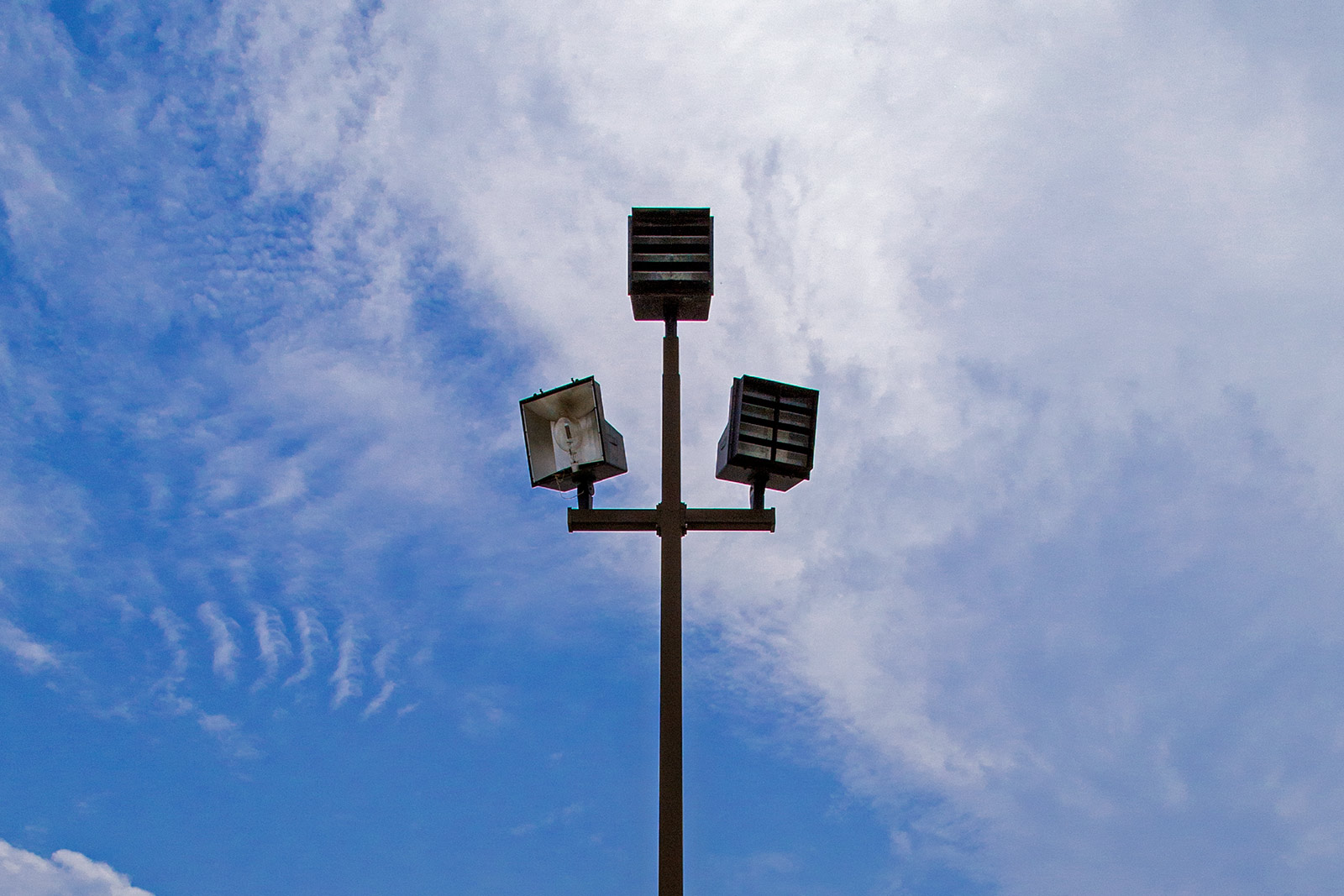 20140629. Parking lot lamp on a partly cloudy sky. Minimal Aesthetic # 35. Lamp # 3.