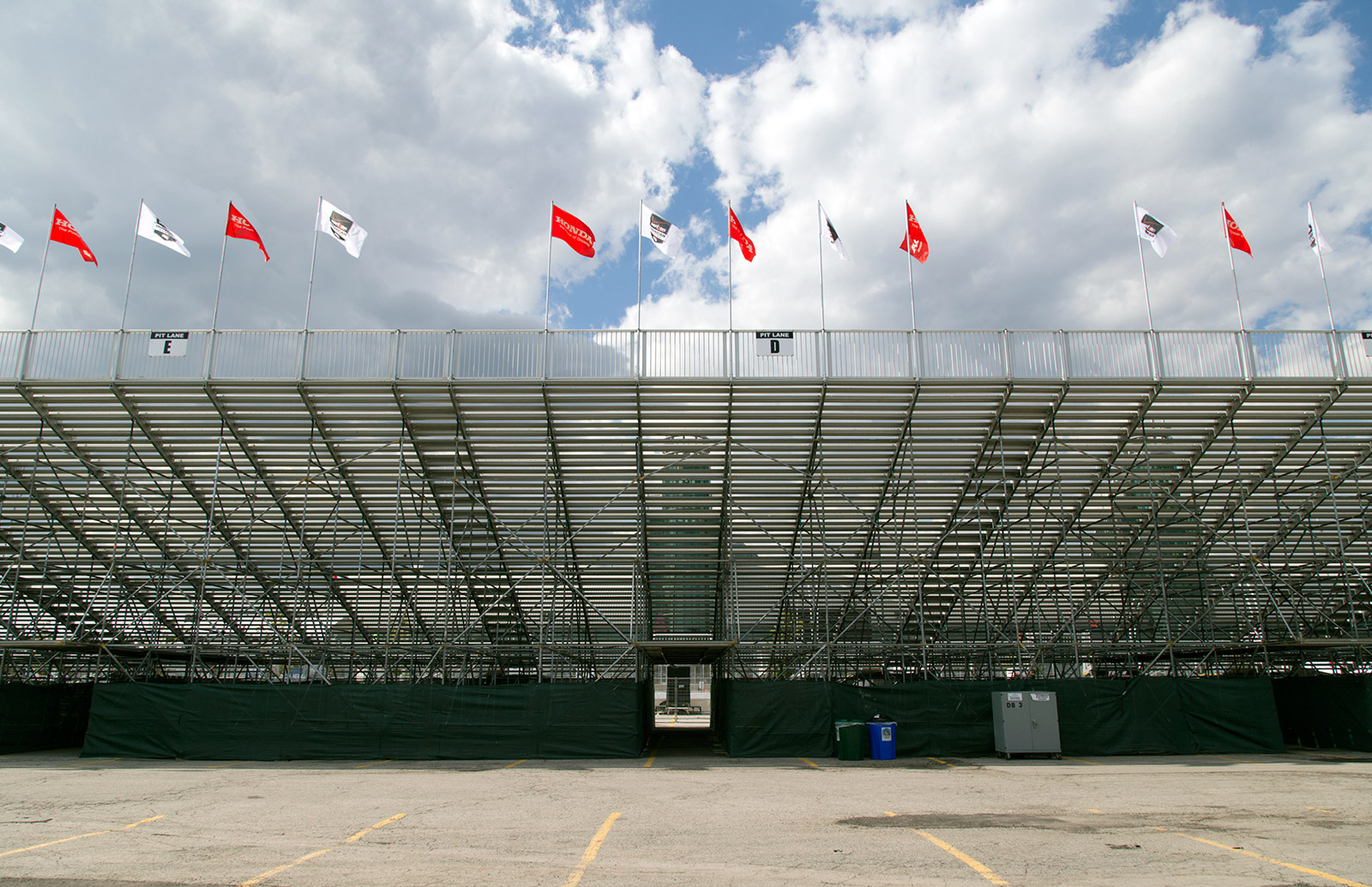 20140718. Flags fly over the green grandstand grid a day before