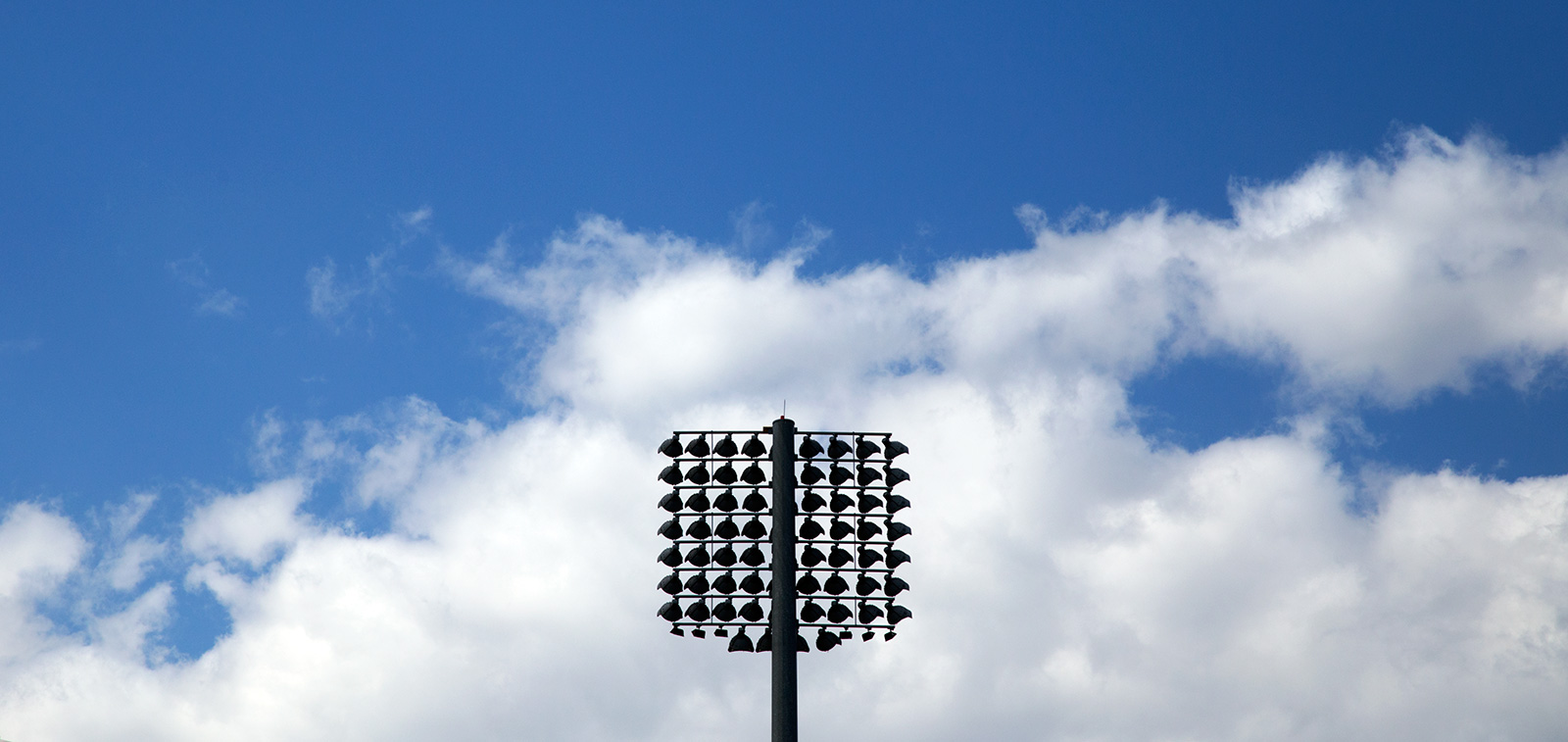 20140720. A silhouette of sport field lights against the sky. Mi