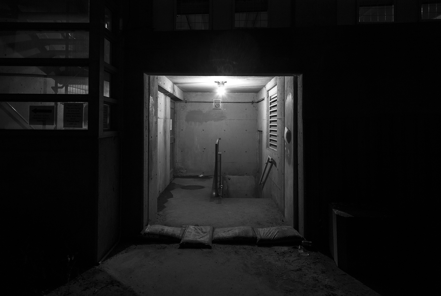 20141001. An door-less flood-prone parkade vestibule at night. M