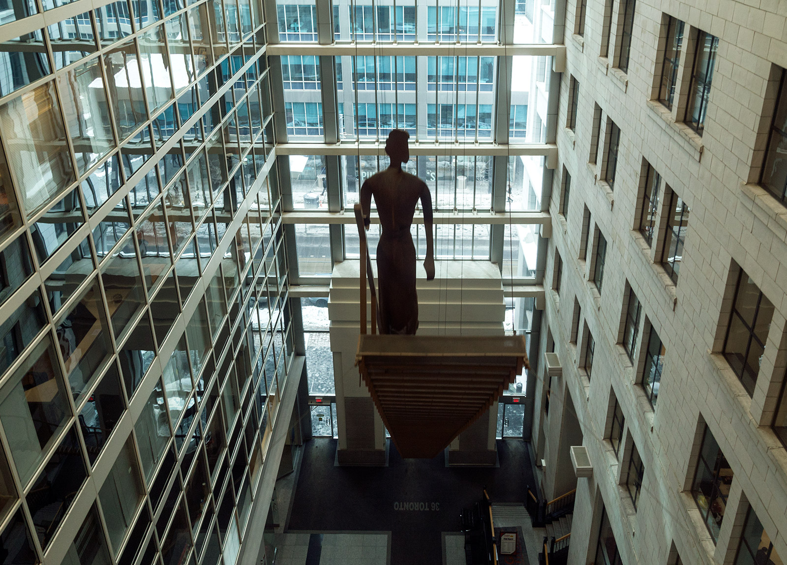 20150303. Sculptures climb suspended stairs inside Toronto's Exc