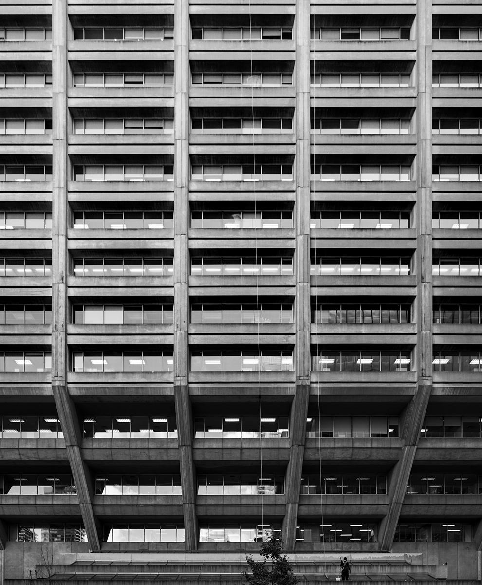 20150402. One man versus a behemoth Brutalist building. Manulife