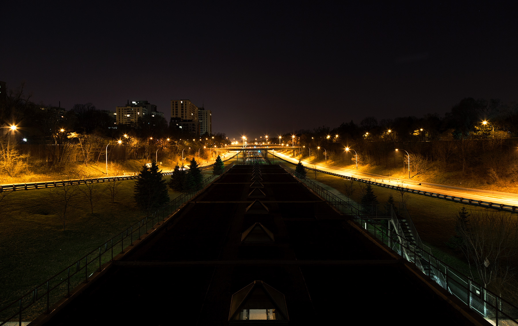 20150419. Above a dark TTC Eglinton West station flanked on both
