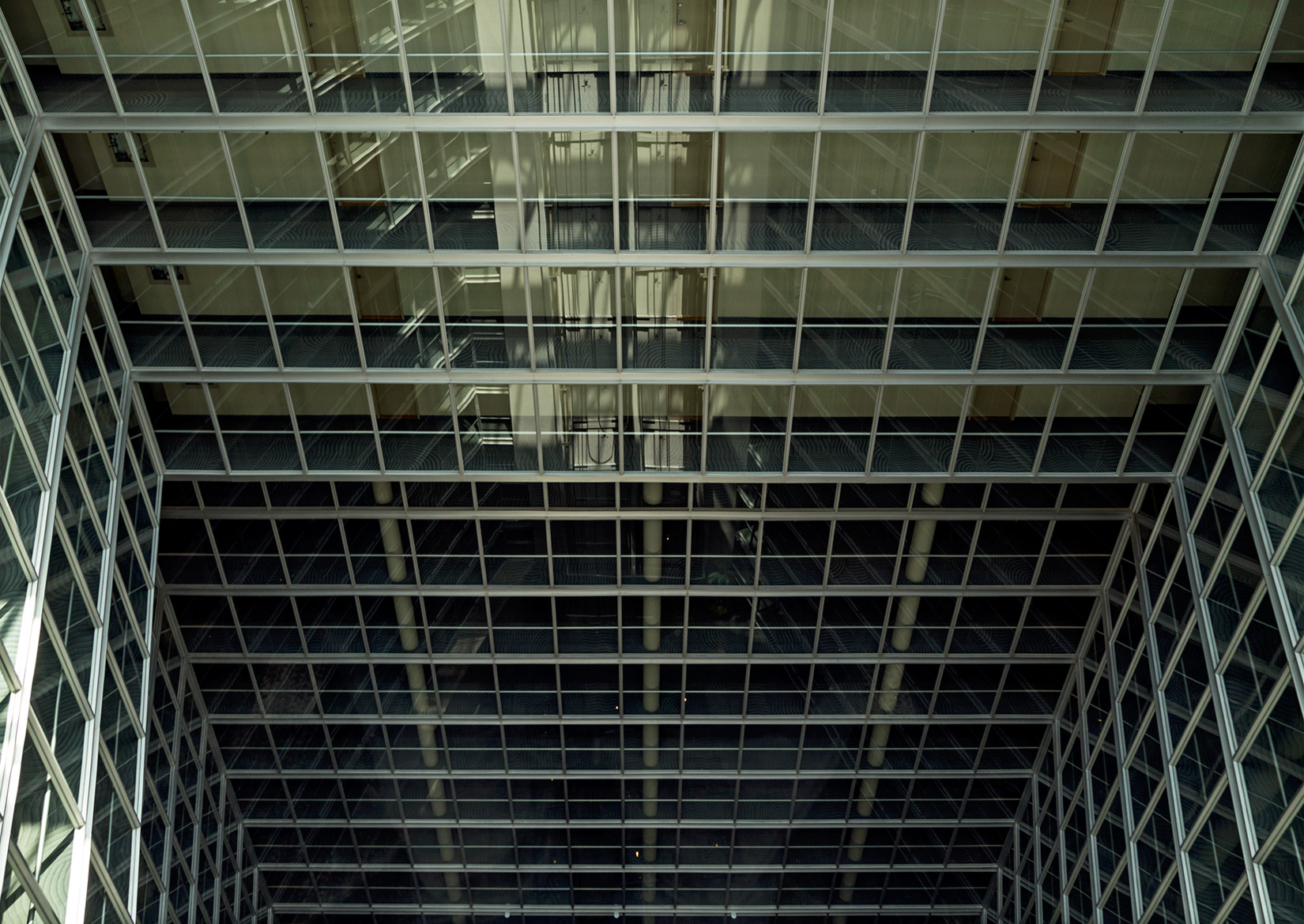 20150725. Looking down a 16 storey neomodern condominium atrum.