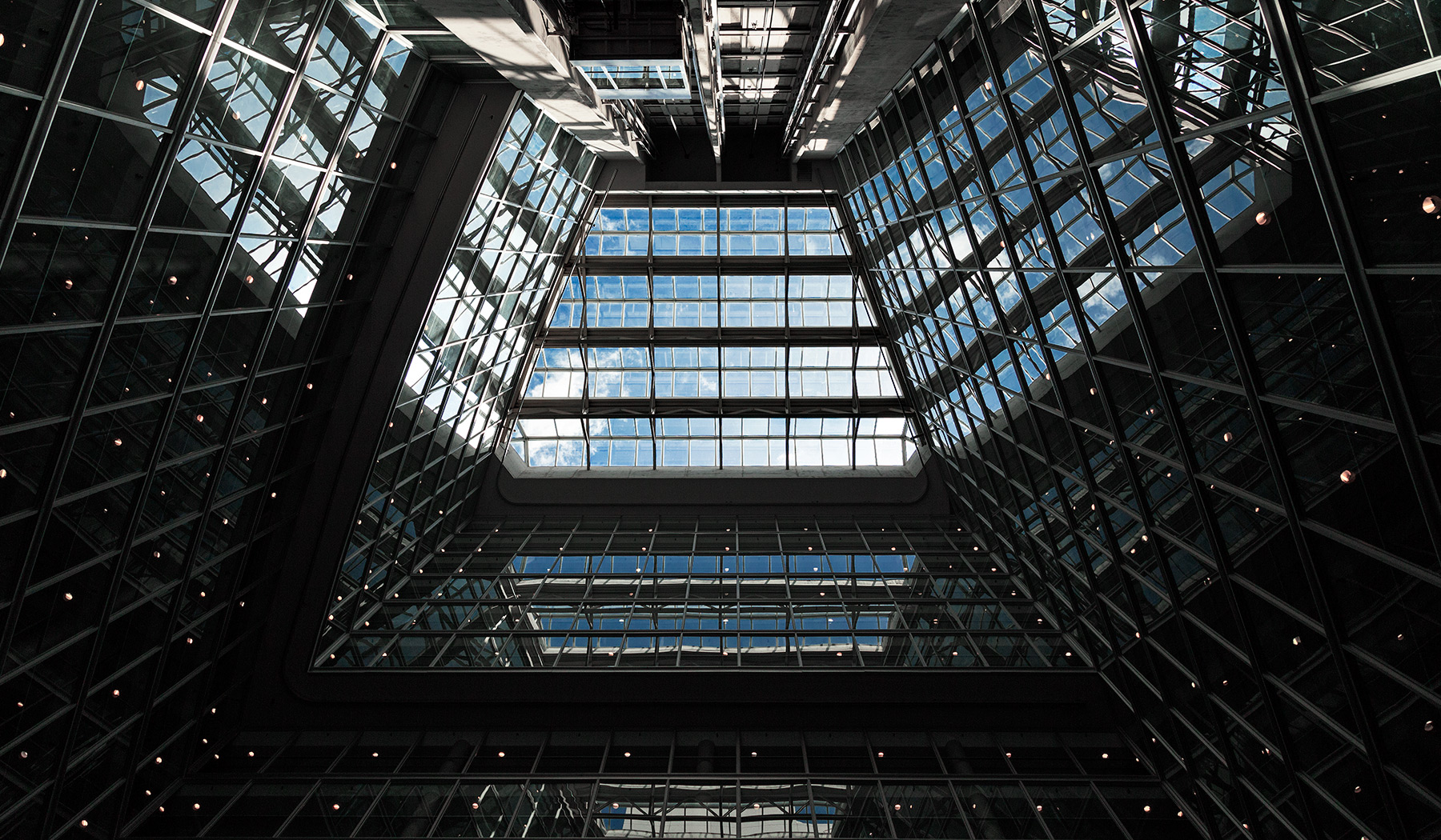 20150904. Looking up a 16 storey neomodern condominium atrium.