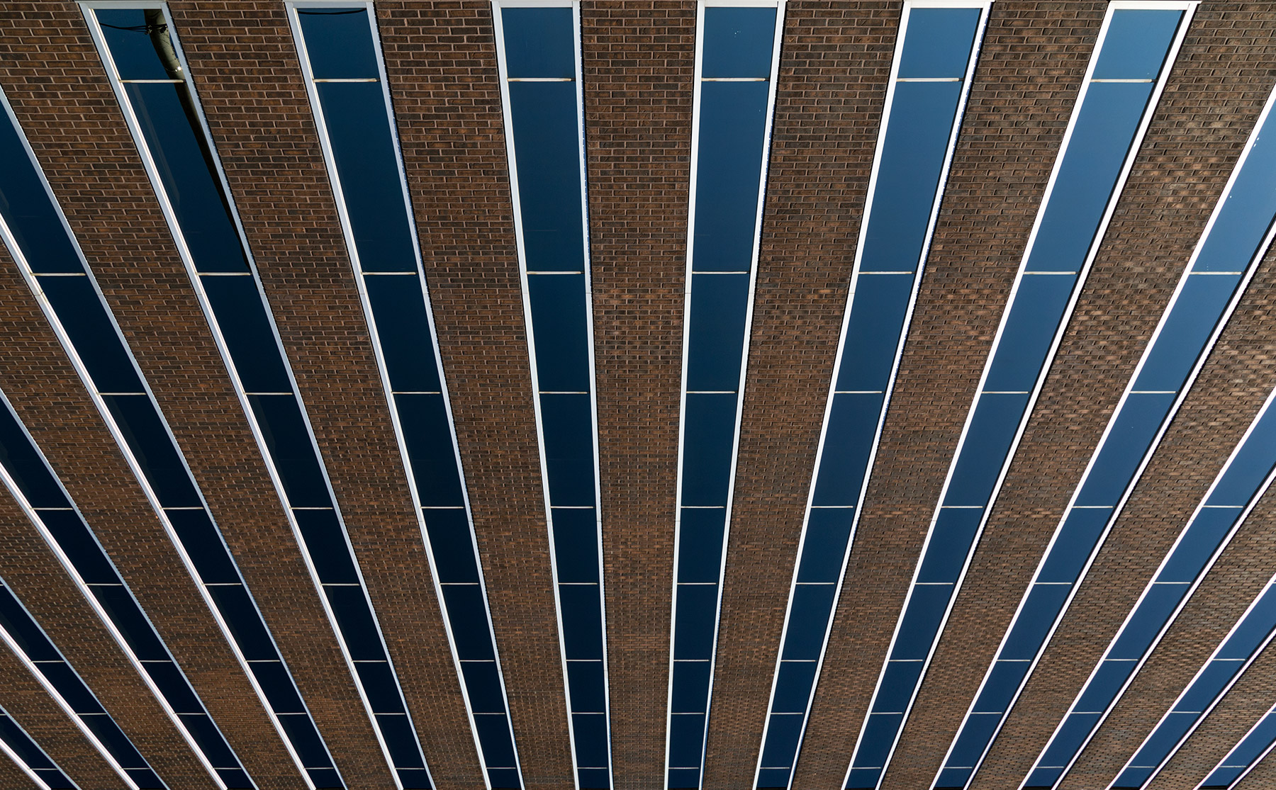 20151011. An uptown post-modern brick and glass abstraction. Min