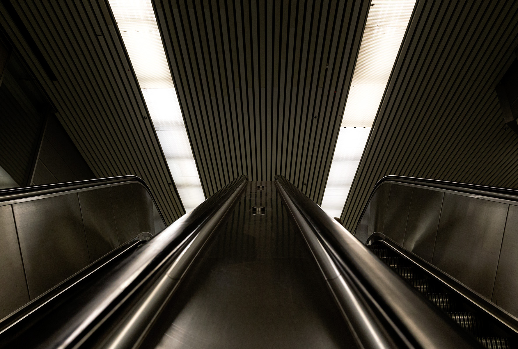 20151015. Seeking symmetry on a moving subway stairway.