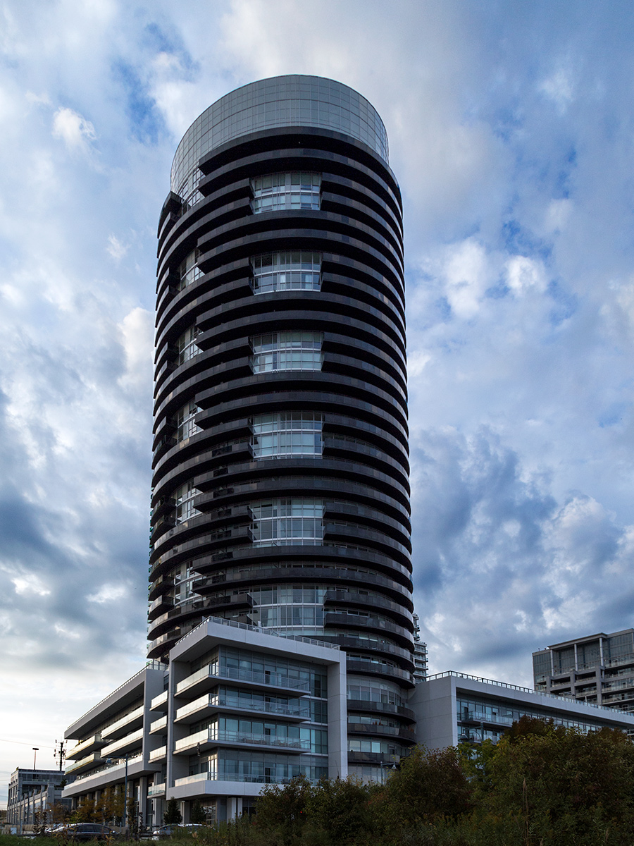 20151203. The unusual elliptical Waterscapes Condos against a dr