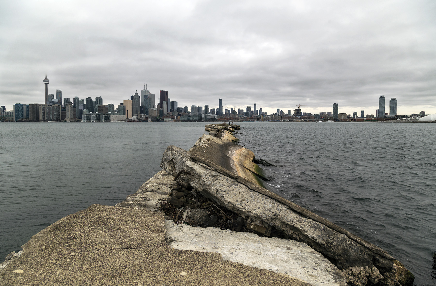 20151228. Derelict concrete pier points to Toronto's skyline.