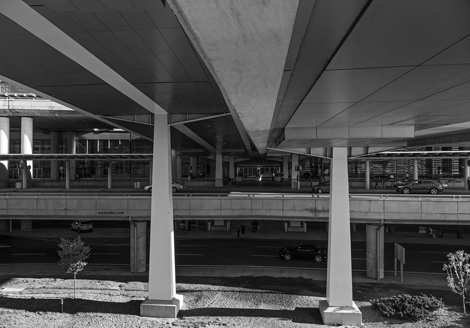 20161027. A parkade perspective below a pair of pedestrian bridg
