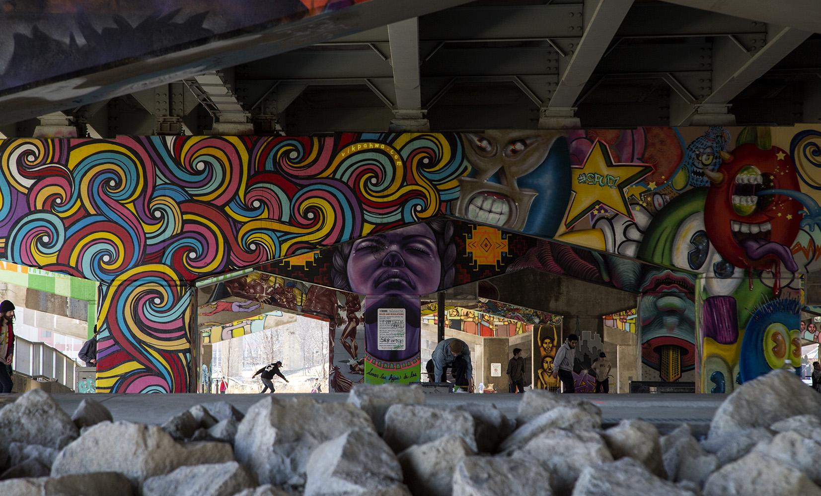 Skateboarding under murals on an unseasonably warm February afte