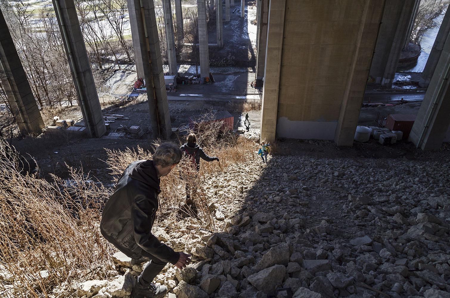 20170311. Expert urban explorers descend the steep concrete rubb